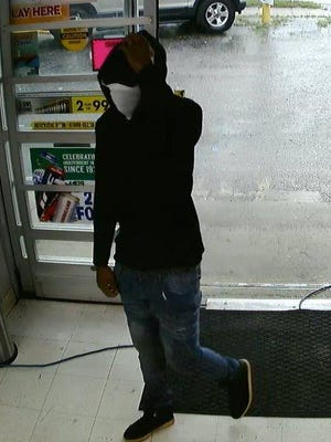 """Escambia County Sheriff's investigators need help identifying an armed suspect who robbed the KNJ Market at 2200 North """"W"""" St. on June 15."""