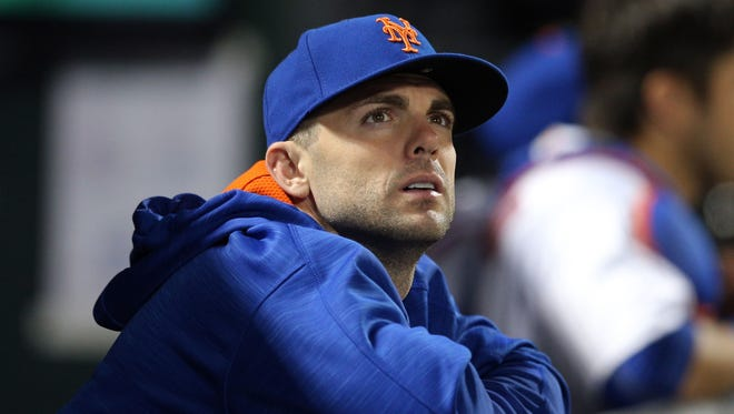 May 30, 2017; New York City, NY, USA; New York Mets injured third baseman David Wright (5) watches from the dugout during the eighth inning against the Milwaukee Brewers at Citi Field. Mandatory Credit: Brad Penner-USA TODAY Sports