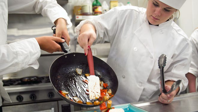 Students cook during a culinary arts course at Millennium High in Goodyear.