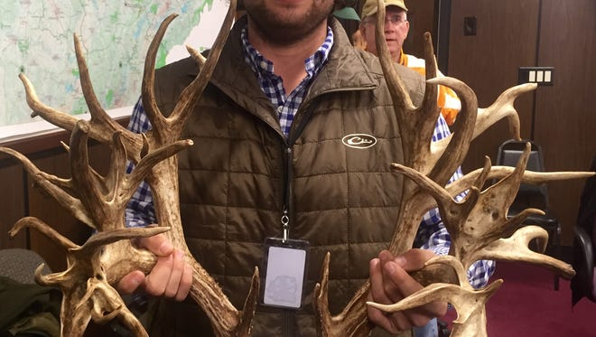 Stephen Tucker of Gallatin holds up the 47-point antlers from the deer he killed in November, which was declared a world record by a panel of Boone and Crockett judges Monday.