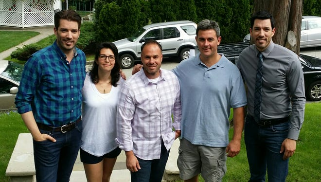 Property Brothers Drew & Jonathan Scott pose with homeowners Olivia and Dan Lopuzzo and realtor Justin Pieragostini (center).