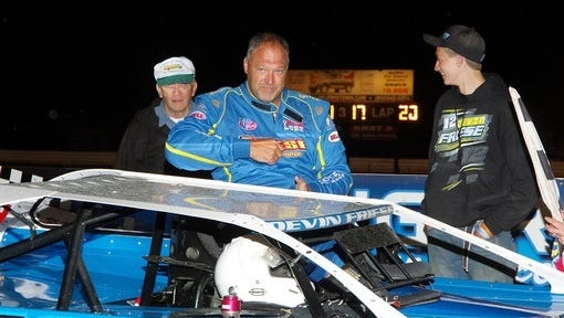 Devin Friese of Chambersburg, flanked by his dad Bob, left, and son, Kelby, exits his car after winning a Late Model race at Port Royal Speedway on Saturday.