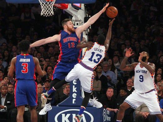 Pistons center Aron Baynes (12) blocks a shot by Knicks
