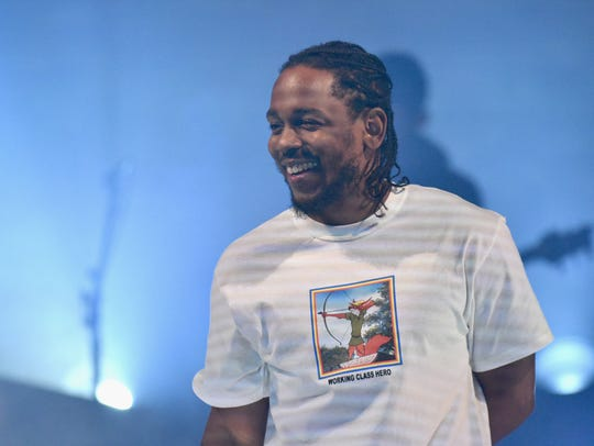 Kendrick Lamar performs onstage during American Express