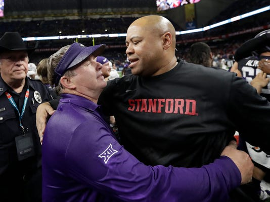 TCU coach Gary Patterson, left, and Stanford coach David Shaw greet each other at midfield after the Alamo Bowl NCAA college football game, Thursday, Dec. 28, 2017, in San Antonio. TCU won 39-37. (AP Photo/Eric Gay)