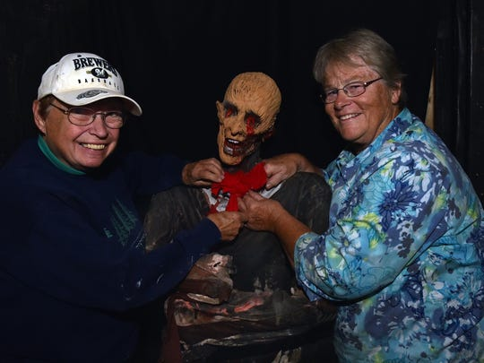 "Haunted Mansion founders Judy Jesse, left, and Sue Marchant with ""Slammer,"" who has been with the popular annual haunted mansion since its inception at Quietwoods South Camping Resort. Both join founders Cory Vandertie and Sue's son Mike Marchant, owner of the campgrounds, in celebrating 10 years as a fund raiser. Slammer has been dressed and redressed every year to transform from a gorilla to a bride."