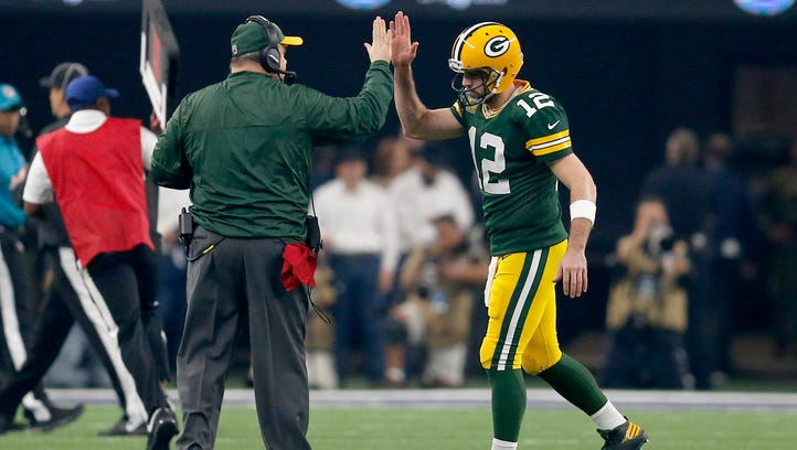Packers quarterback Aaron Rodgers  and head coach Mike