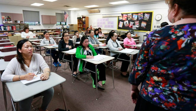 A group of adult Hmong women participate in an English learning class during a Growing Great Minds Program Wednesday, April 26, 2017, at Horace Mann Middle School in Wausau.