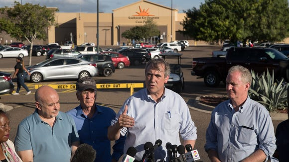 Sen. Jeff Merkley of Oregon gives a statement regarding family separation after visiting the Southwest Key Casa Padre Facility in Brownsville on Sunday, June 17, 2018. Sen. Chris Van Hollen of Maryland stands beside Merkley.