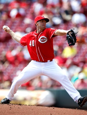 Reds starting pitcher Dylan Axelrod throws during the first inning Thursday afternoon at Great American Ball Park.