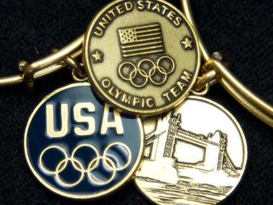 Olympic commemorative Alex and Ani charms are shown in this 2012 photo. The company, founded by Carolyn Rafaelian in 2004, has expanded throughout the country and now sells internationally.