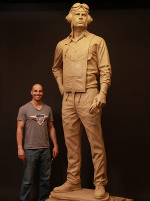 Benjamin Victor, left, created the statue of Cecil Harris that will be dedicated at Northern State University in Aberdeen, S.D., on Saturday, June 14, 2014.