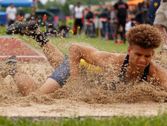 Grand Ledge's Kavion Autrey lands in long jump in the