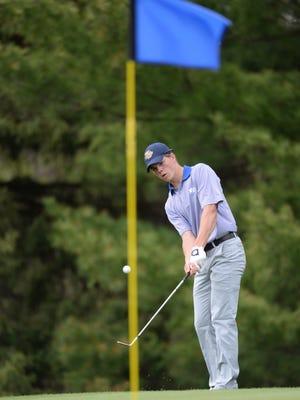 Notre Dame Academy golfer Robert Petitjean chips onto the green at hole No. 2 at the Brown County Golf Course Friday, May 8, 2015.