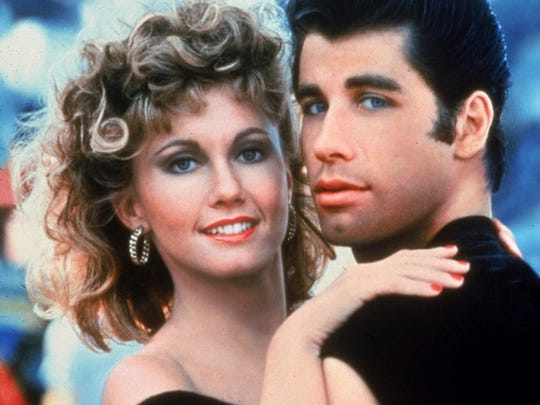 "Olivia Newton-John and John Travolta in the film adaptation of ""Grease."""