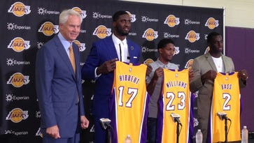 Los Angeles Lakers general manager, Mitch Kupchak, far left, introduces three NBA veterans, Roy Hibbert, 17, Lou Williams, 23, and Brandon Bass, 2, during a news conference in El Segundo, Calif.