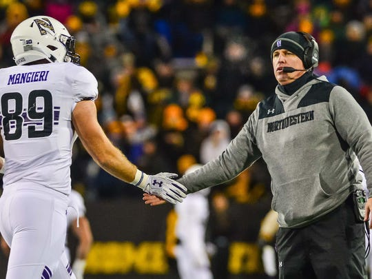 Northwestern Wildcats head coach Pat Fitzgerald reacts with wide receiver Charlie Mangieri (89) during the fourth quarter against the Iowa Hawkeyes at Kinnick Stadium this past season. Fitzgerald was in Naples on Tuesday to speak to area alumni.