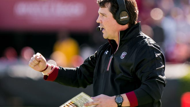 USC coach Will Muschamp talked former Duke assistant John Latina out of retirement to coach the Gamecocks' offensive line in the Birmingham Bowl.