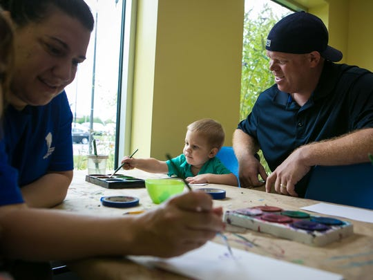 Kevin Brackney of Wilmington paints with his son Nicholas, 2, daughter Gianna, 5, and wife Gianine at the Children's Museum as part of a Wounded Warriors Project expedition.