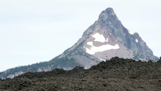With Mount Washington looming in the distance, hikers make their way along the Pacific Crest Trail.