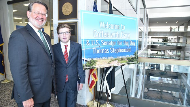 """U.S. Sen. Gary Peters, D-Mich., stands with 18-year-old Tom Stephenson of Greenville, Mich. Stephenson, who has a critical heart condition, was granted his wish of being a """"senator for a day"""" made through the Make-A-Wish Mid-Atlantic group."""