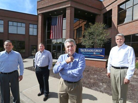 Bonadio Group CEO Thomas Bonadio, second from right,