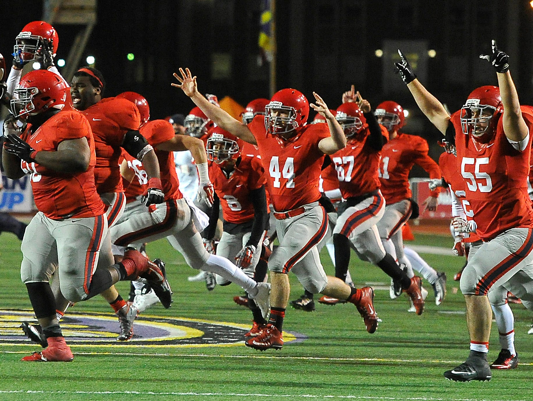 Brentwood Academy celebrates its double-overtime win over Montgomery Bell Academy 56-55 in the BlueCross Bowl DII-AA state title game on Dec. 3, 2015, in Cookeville.