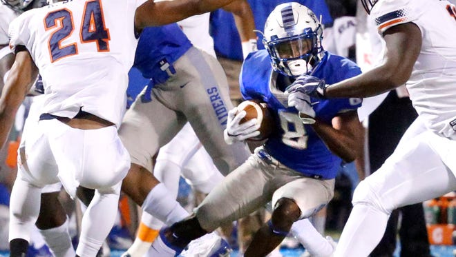 MTSU's Ty Lee (8) runs the ball during the game against UTEP, on Saturday, Nov. 4, 2017, at MTSU.