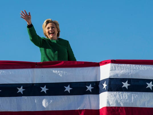 Hillary Clinton waves as she boards her campaign plane after a rally in Raleigh, N.C.,