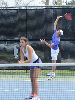 Wylie's Davyn Williford serves behind mixed doubles partner Kaitlyn Hathorn during the final in the Abilene Eagle Invitational at McMurry on Saturday, March 24, 2018. Williford and partner Hathorn won the title 6-3, 6-2.