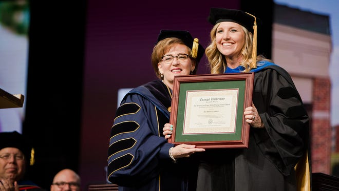 Dr. Shonna Crawford, right, received the Mills Young Faculty Award for Excellence in Teaching, Scholarship and Service from Evangel University President Dr. Carol Taylor, during the spring commencement ceremony.
