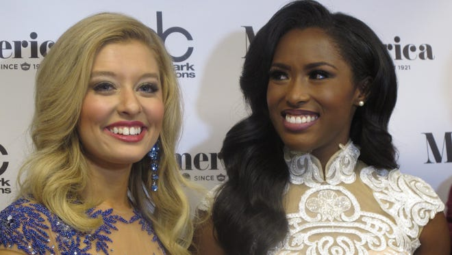 Miss Iowa Taylor Wiebers, left, who won the talent competition, stands next to Miss South Carolina Daja Dial, who won the swimsuit competition, during the first night of preliminary competition in the Miss America pageant on Tuesday Sept. 8, 2015 in Atlantic City, N.J. The new Miss America will be crowned in Sunday night's nationally televised finale.