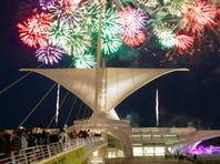The U.S. Bank Fireworks Show light up the sky over the Milwaukee Art Museum on the Lake Michigan July 3.