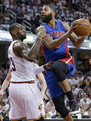 Detroit Pistons forward Marcus Morris, right, drives against the Cleveland Cavaliers' LeBron James in the second half of Game 2 Wednesday, April 20, 2016, in Cleveland. The Cavaliers won, 107-90.