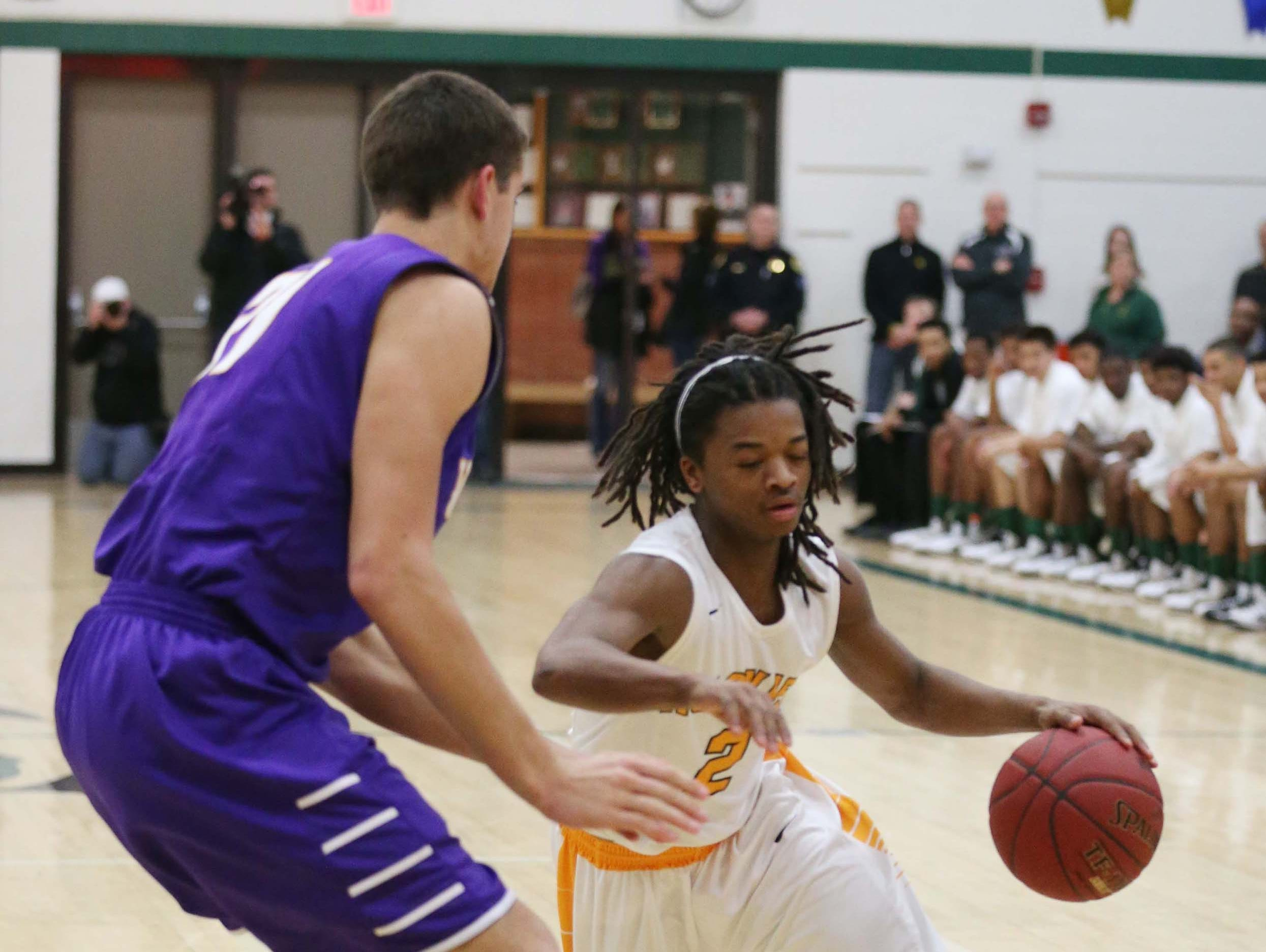 Hoover's Khallid Edwards drives to the basket on Feb. 10 against Waukee.