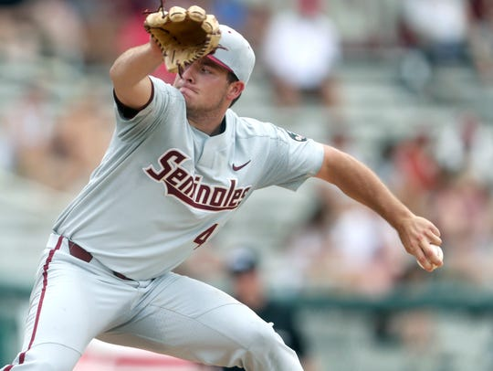 Florida State's Drew Parrish pitches against Mississippi