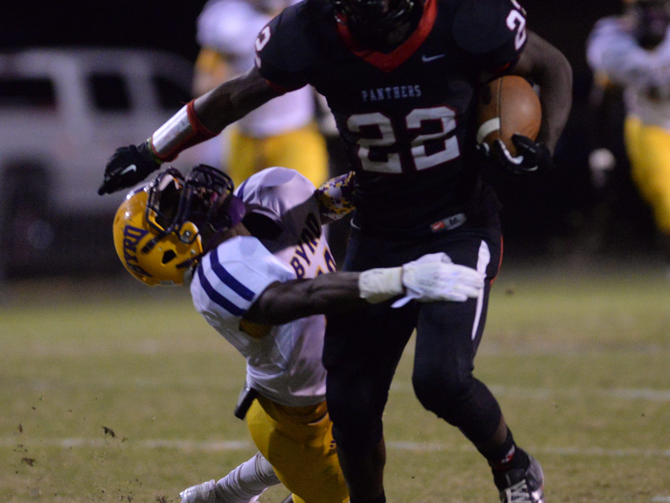 Parkway running back Robert McKnight looks to evade a tackler in a 20-6 win over Byrd last season.