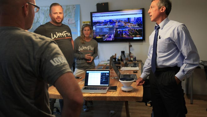 Gov. John Carney speaks with members of the internet service provider WhyFly at The Mill co-working space in Wilmington Friday.