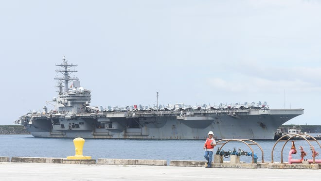 The Nimitz-class nuclear-powered supercarrier, USS Ronald Reagan, docks at Apra Harbor as part of a goodwill visit on Sept. 24, 2015.