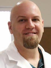 Eli Greenbaum, associate professor of evolutionary