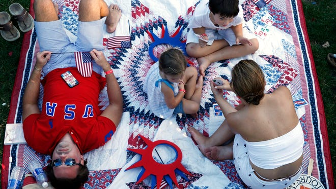 The Walker family of Lafayette, La., relaxes while waiting for the start of the Boston Pops Fourth of July Concert.