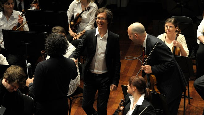 This file image shows Ben Folds unveiling a new piano concerto for area high school students at the Nashville symphony's Young Peoples Concert on Friday March 14, 2014.
