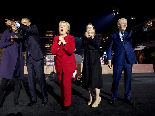 In this Monday, Nov. 7, 2016, photo, Democratic presidential candidate Hillary Clinton, center, is joined onstage by first lady Michelle Obama, left, President Barack Obama, second from left, Chelsea Clinton, second from right, and former President Bill Clinton, right, after speaking at a rally at Independence Mall in Philadelphia. The former secretary of state, senator and first lady is working on a collection of personal essays that will touch upon the 2016 presidential campaign, Simon & Schuster told The Associated Press on Wednesday, Feb. 1, 2017. The book, currently untitled, is scheduled for this fall and will be inspired by favorite quotations she has drawn upon. (AP Photo/Andrew Harnik, File)