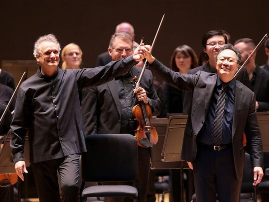Yo-Yo Ma took bows with Louis Langrée, and then sat at the back of the orchestra in the program's second half at the Taft Theatre, Downtown