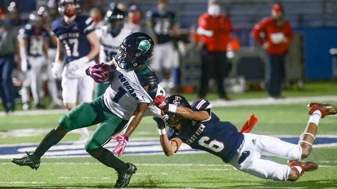 East View cornerback Michael Sedwick tries to drag down Connally running back McAnthony Everest during East View's 62-6 win Friday at Birklebach Stadium in Georgetown.