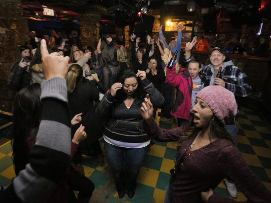 Patrons of Washington's Sports Bar dance during Wash