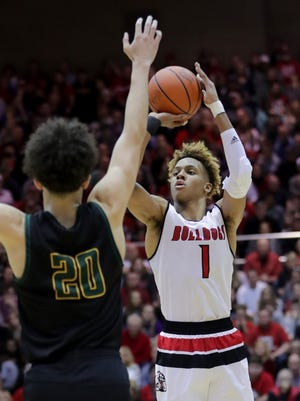 New Albany's Romeo Langford knocks down a shot over Floyd Central's Luke Gohmann in the Indiana 4A Sectional final. March 3, 2018