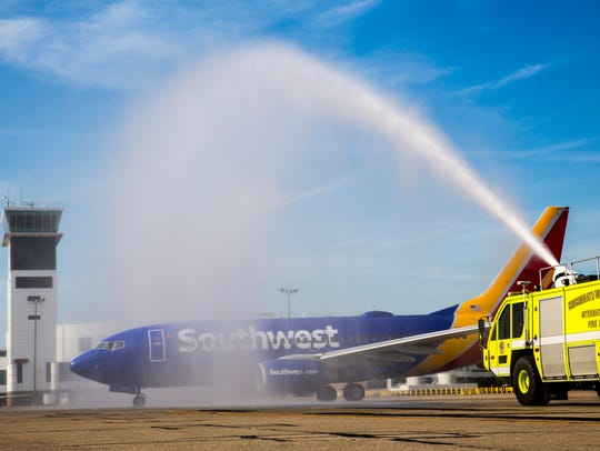 The CVG fire department sprays a ceremonial water arch