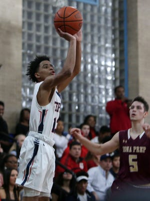 Stepinac's RJ Davis puts up a shot in front  of Iona's Nick Brennen (5) during basketball acton at Stepinac High School in White Plains Feb. 3, 2017.