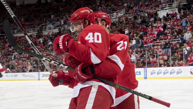 Tomas Tatar, right, hugs Red Wings center Henrik Zetterberg after the captain's goal Thursday.